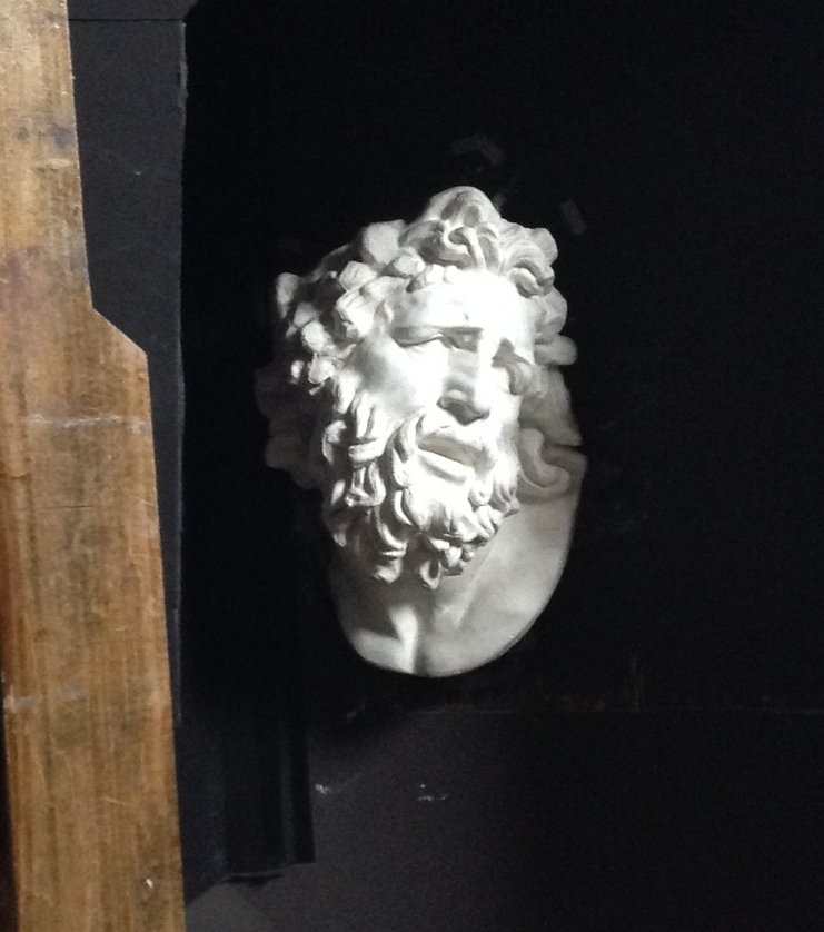 Laocoön in his shadow box home.