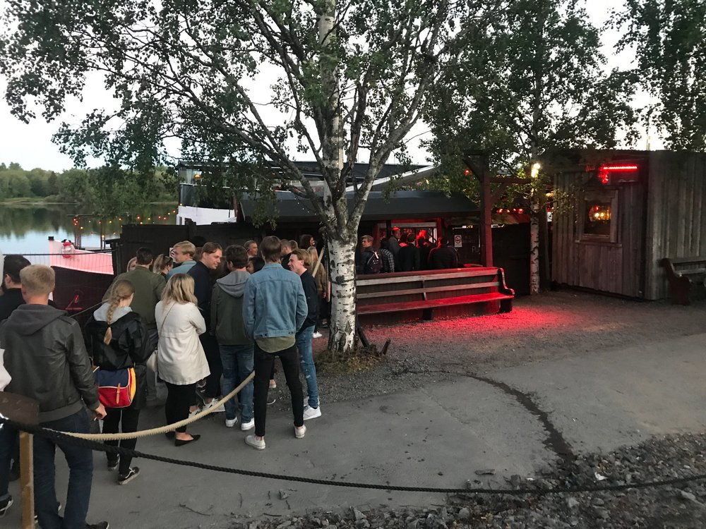 "In line for ""The Boat"" (Pirate ship bar? Modern Valhalla? All of the above?) Typical midnight in Umeå."