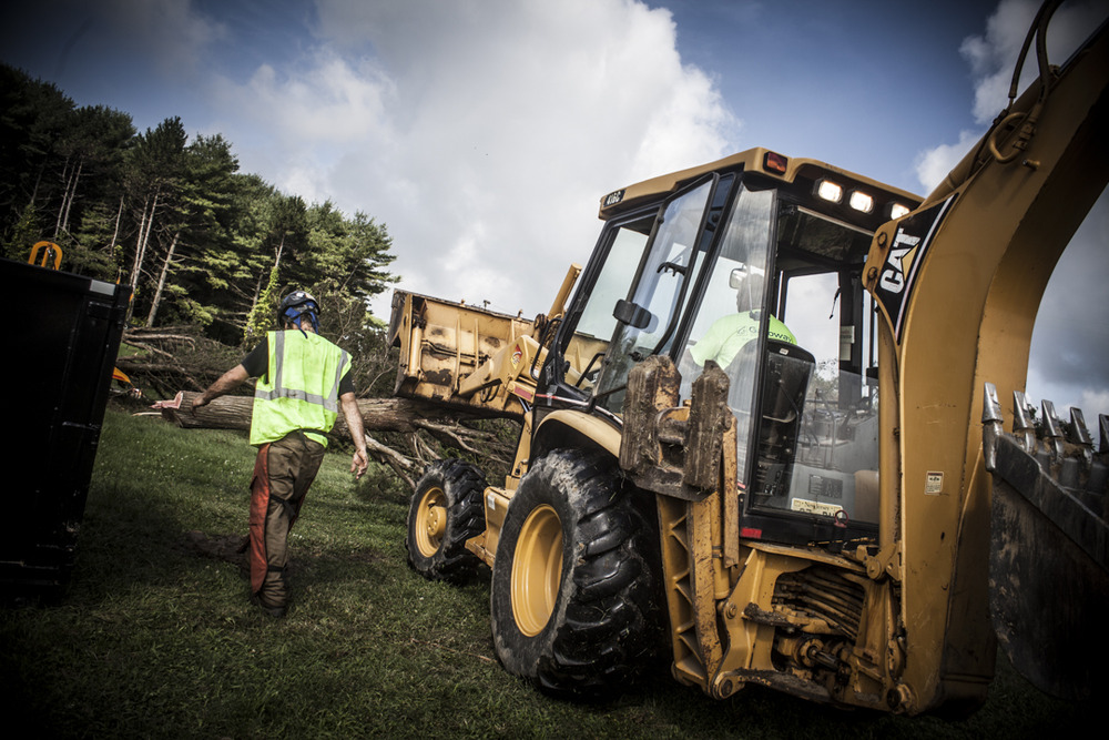 Moving trees with our CAT loader. (Photo: Joint Base McGuire-Dix-Lakehurst site work)
