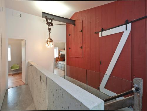 a modern house built inside of a barn!!