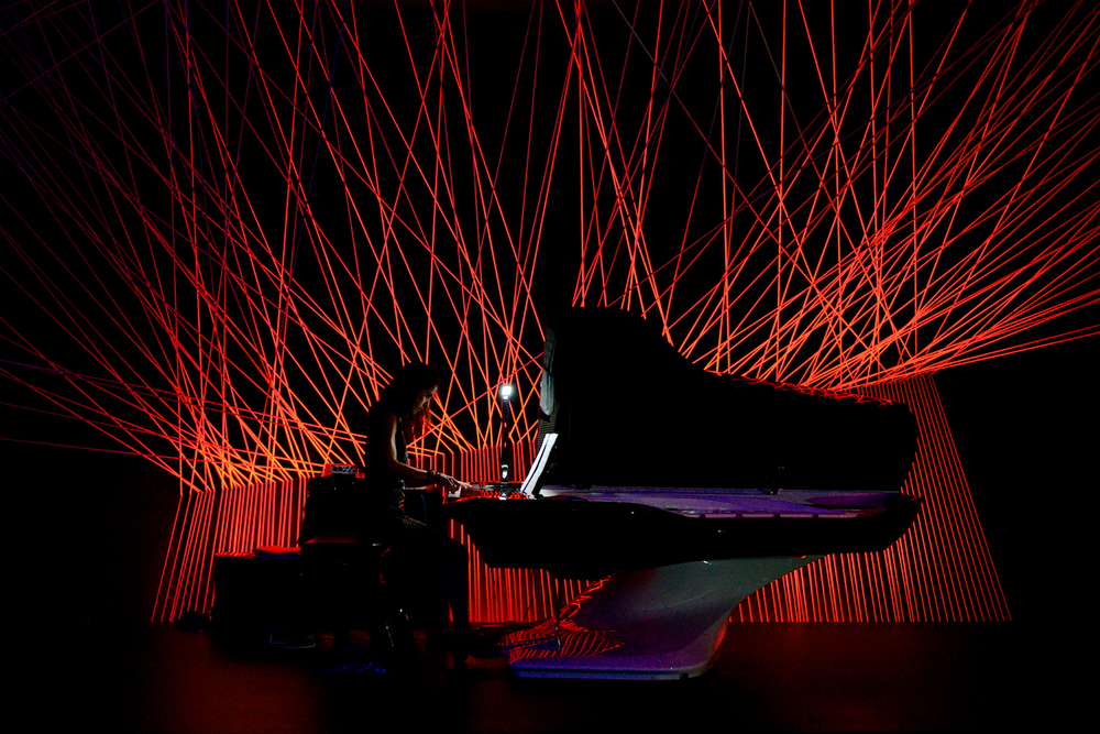 In a dark room within the Peugeot Design Lab a pianist played the Pleyel-Peugeot piano while the lighting's colours changed
