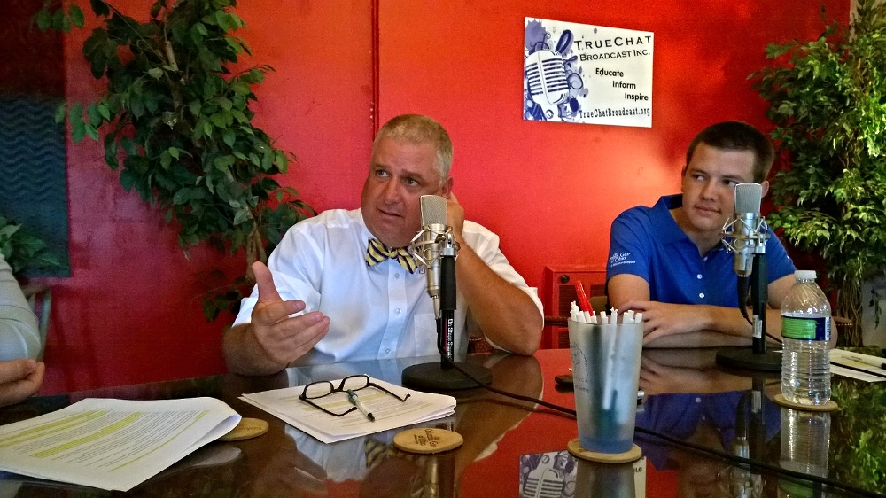 Lance Jackson, left, discusses relevant political issues with Camden Pierce and Jacob Circle, right, on the Current Issues Show at Studio 1A in Urbana, OH.