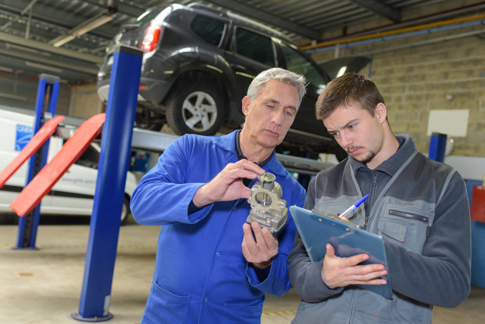 Student with auto part studying automotive trade.jpg
