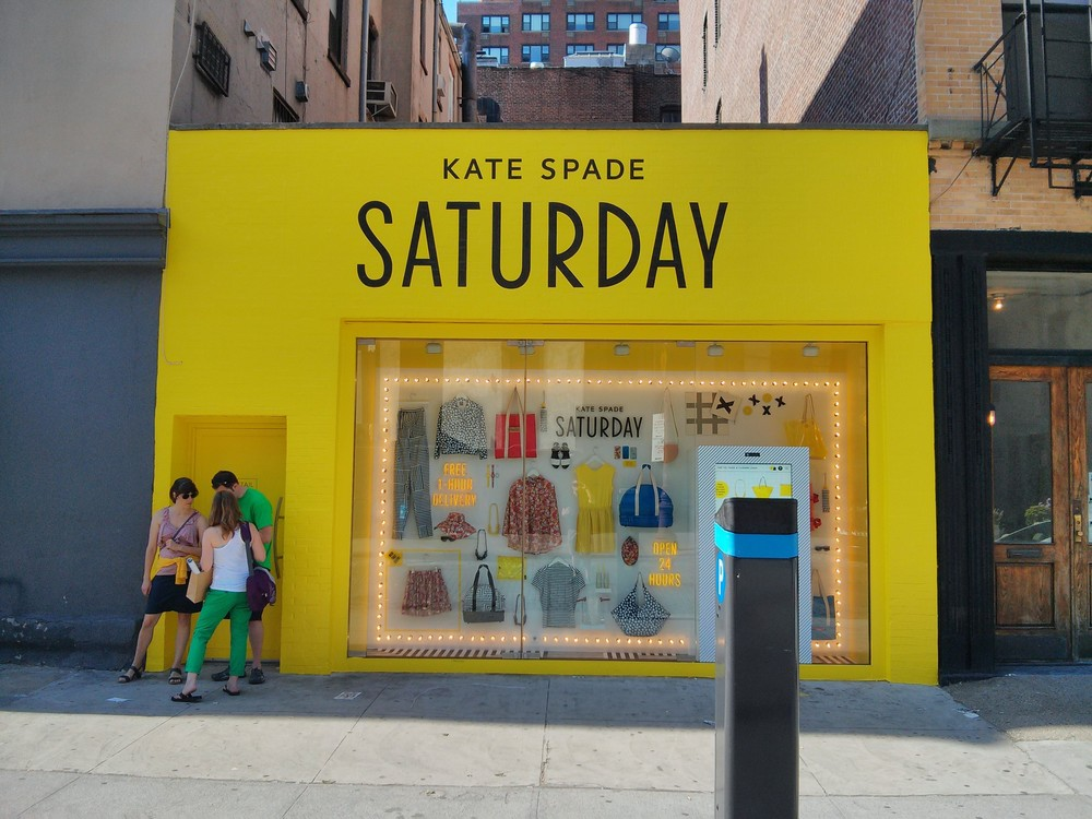 Browse for what you want, but only the stuff they show you! Kate Spade Saturday storefront. The partially obscured (sorry!) touchscreen is to the right, just behind the parking kiosk.