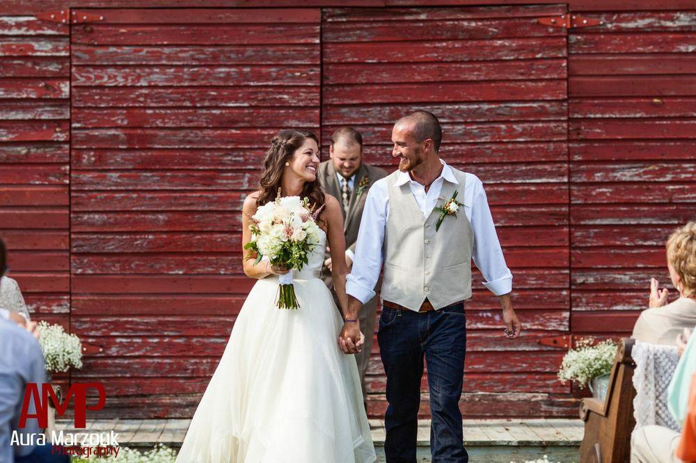 Sara and Bart's homegrown DIY barn wedding in Seagrove, North Carolina. Image © Aura Marzouk Photography