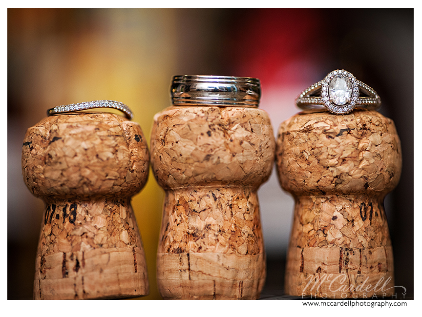 Engagement rings and wedding bands photographed on top of wine corksat Starmount Country Club in Greensboro, North Carolina. Images courtesy of McCardell Photography, a Greensboro, North Carolina Wedding Photographer.