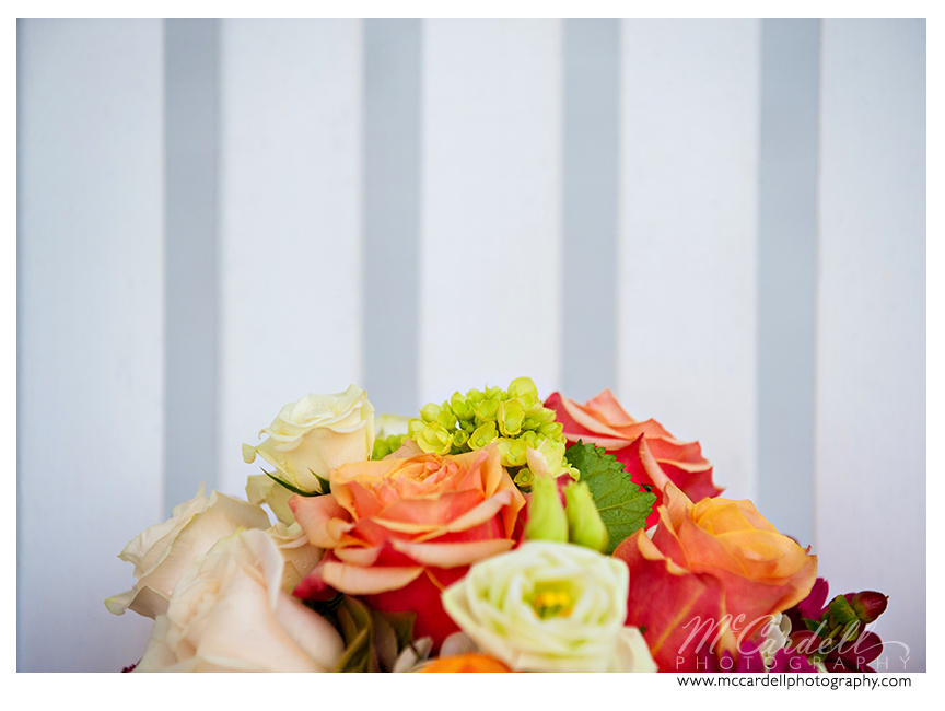 Orange, ivory and green bouquets by Botanica Flower and Gifts in Greensboro, North Carolina. Images courtesy of McCardell Photography, a Greensboro, North Carolina Wedding Photographer.