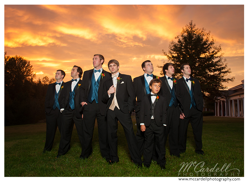 Groomsmen in black suits and teal vests and bow ties at this Starmount Country Club wedding in Greensboro, North Carolina. Images courtesy of McCardell Photography, a Greensboro, North Carolina Wedding Photographer.