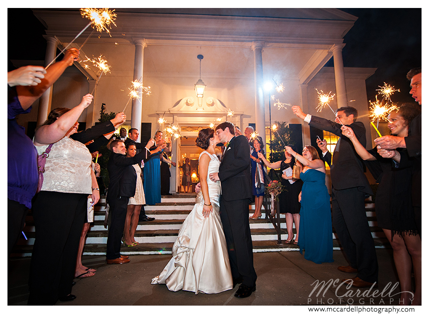 Sparkler exit at this teal and orange Starmount Country Club wedding in Greensboro, North Carolina. Images courtesy of McCardell Photography, a Greensboro, North Carolina Wedding Photographer.