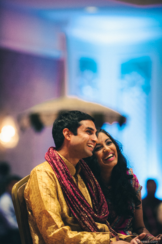 Bride and groom at their Indian rehearsal dinner featuring stunning cultural decor at the Grandover Resort in Greensboro, North Carolina. Images by Vesic Photography.