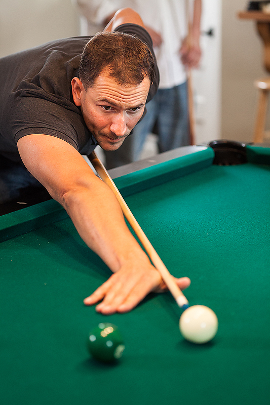 Groom plays pool as he prepares for his Winmock at Kinderton wedding, a TriadWeddings venue. Image by Elly's Photography.