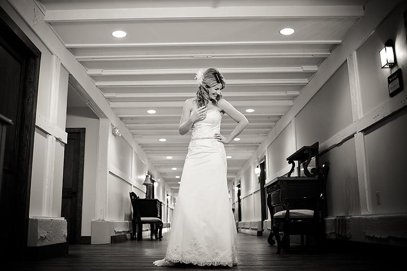Bride poses in the hallways of Winmock at Kinderton in Bermuda Run, a TriadWeddings venue. Image by Elly's Photography.