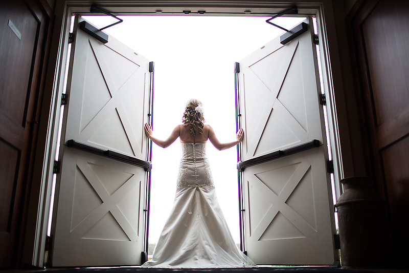 Bride poses in the hallways of Winmock at Kinderton in Bermuda Run, a TriadWeddings venue. Image by Elly's Photography.