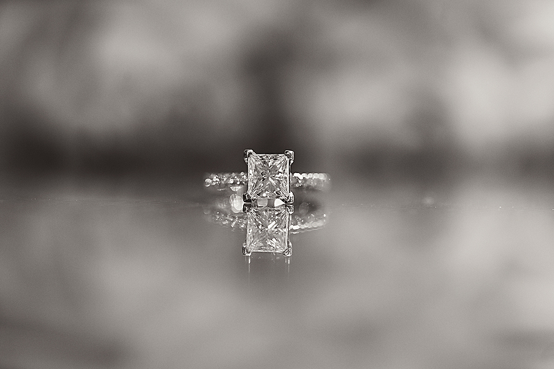 Stunning engagement ring on the glass tables at Winmock at Kinderton in Bermuda Run, a TriadWeddings venue. Image by Elly's Photography.