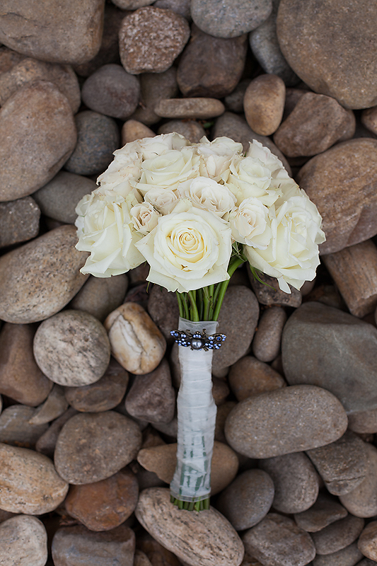 Stunning white rose bouquet from Whole Foods at this Winmock at Kinderton wedding, a TriadWeddings venue. Image by Elly's Photography.