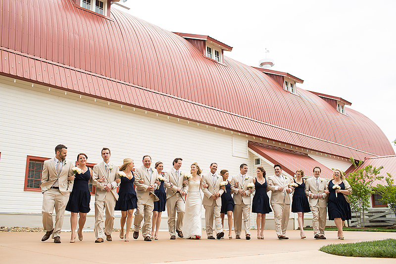 Navy bridesmaid dresses and beige suits on the wedding party at the Winmock at Kinderton in Bermuda Run, a TriadWeddings venue. Image by Elly's Photography.