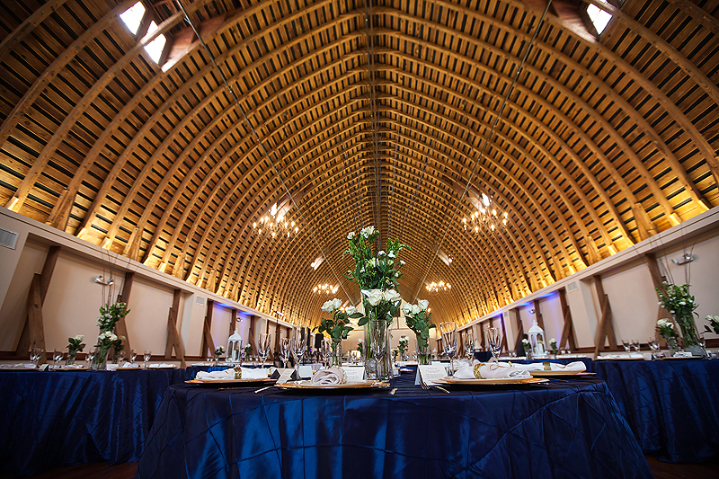 Stunning navy and ivory reception at this Winmock at Kinderton wedding in Bermuda Run, a TriadWeddings vendor. Image by Elly's Photography.