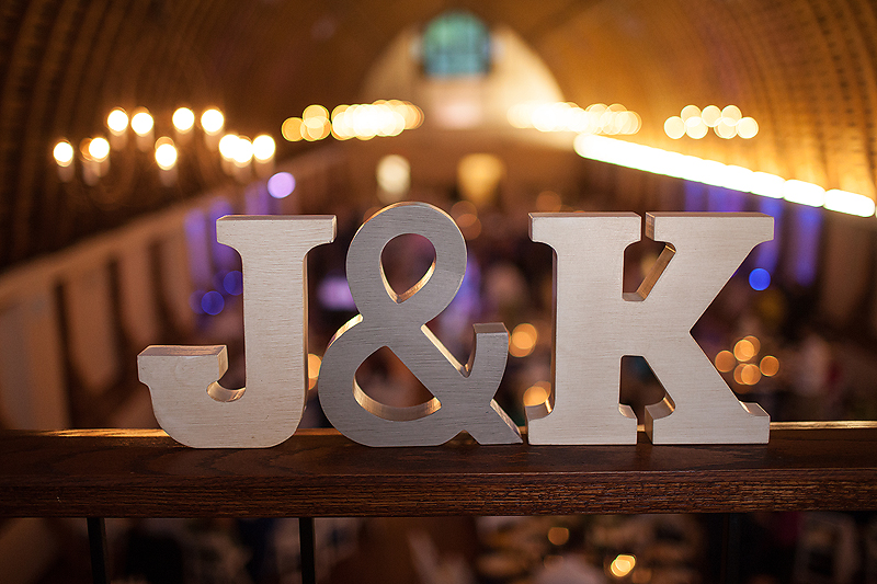 Navy and ivory reception featuring wooden letters for bride and groom names J & K, at this Winmock at Kinderton wedding in Bermuda Run, a TriadWeddings vendor. Image by Elly's Photography.