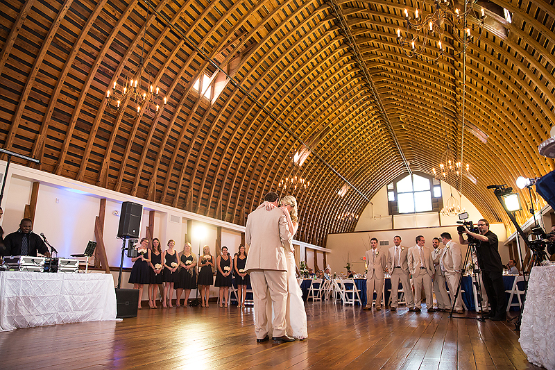 Jim Mayberry performs while bride and groom do their first dance at this Winmock at Kinderton wedding in Bermuda Run, A TriadWeddings vendor. Image by Elly's Photography.