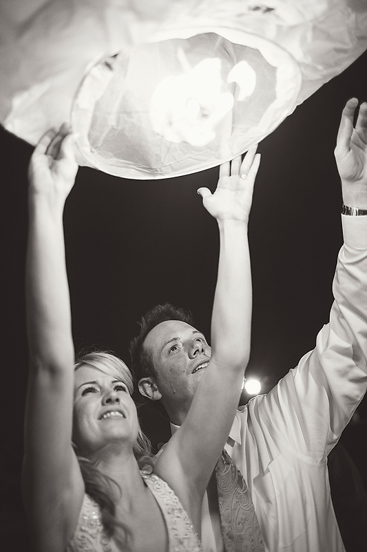 Bride and groom release paper lanterns at their Winmock at Kinderton wedding in Bermuda Run, A TriadWeddings vendor. Image by Elly's Photography.