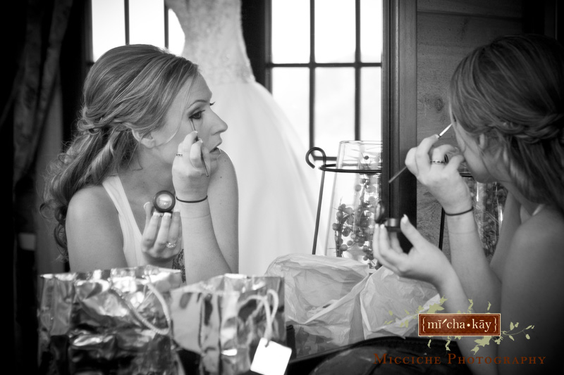 Bride puts on her makeup at her Autumn Creek Vineyards military wedding, a TriadWeddings venue in Mayodan, NC. Image by Mike Micciche Photography, TriadWeddings photographer in Greensboro.