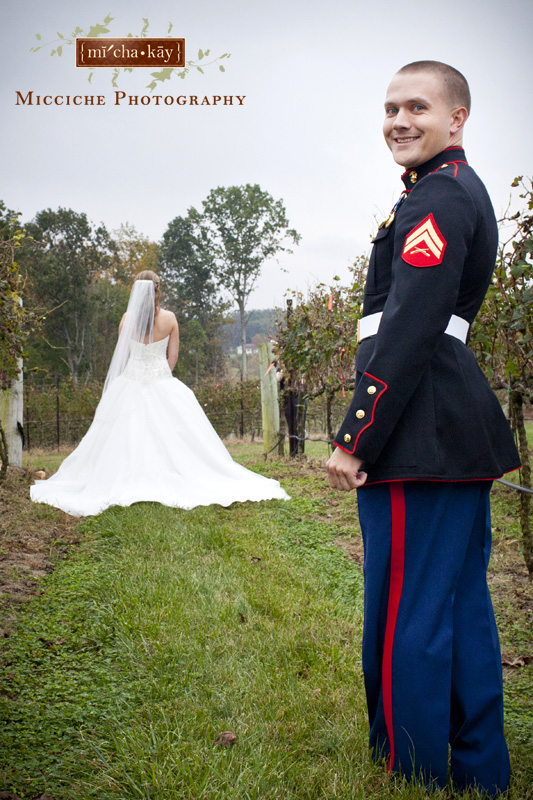 Groom smiles as he prepares for the first look at this military wedding at Autumn Creek Vineyards, a TriadWeddings venue in Mayodan, NC. Image by Mike Micciche Photography, TriadWeddings photographer in Greensboro.