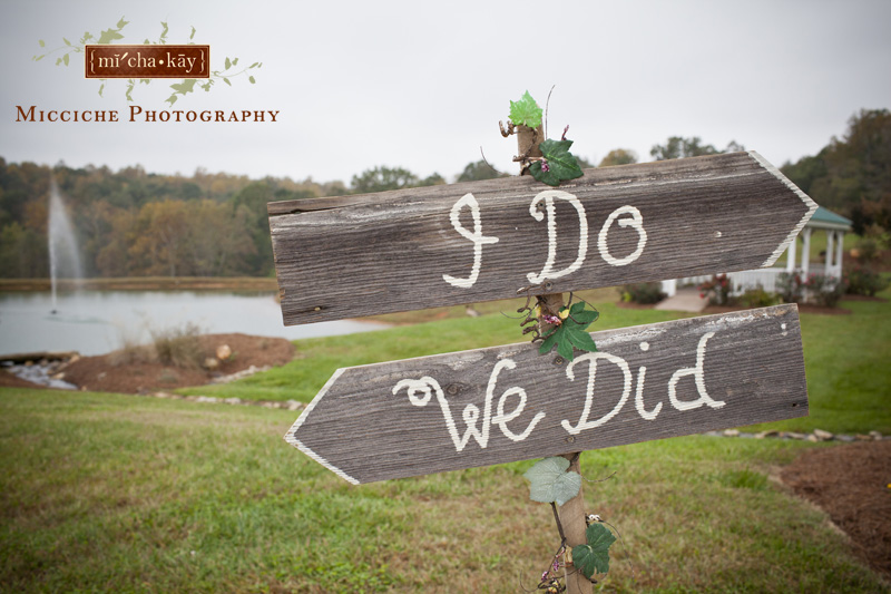 "Wooden arrows with ""I Do"" and ""We Did"" direct people to the ceremony and reception areas at Autumn Creek Vineyards, a TriadWeddings venue in Mayodan, NC. Image by Mike Micciche Photography, TriadWeddings photographer in Greensboro."