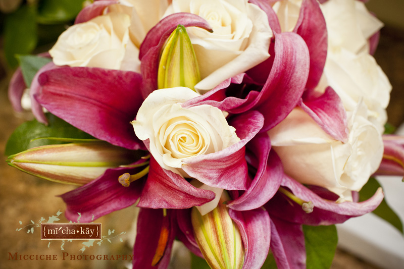 Bouquets include white roses and pink day lilies at this Autumn Creek Vineyard wedding, a TriadWeddings venue in Mayodan, NC. Image by Mike Micciche Photography, TriadWeddings photographer in Greensboro.