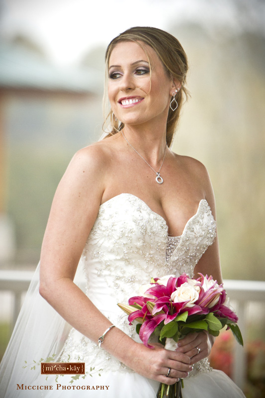 The beautiful bride, Eleanor, poses at her Autumn Creek Vineyard military wedding with her pink and white bouquet. Image by Mike Micciche Photography, TriadWeddings photographer in Greensboro.