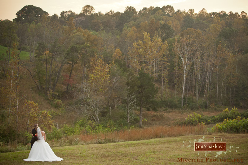 Bride and groom pose at sunset at this Autumn Creek Vineyard military wedding, a TriadWeddings venue in Mayodan, NC. Image by Mike Micciche Photography, TriadWeddings photographer in Greensboro.