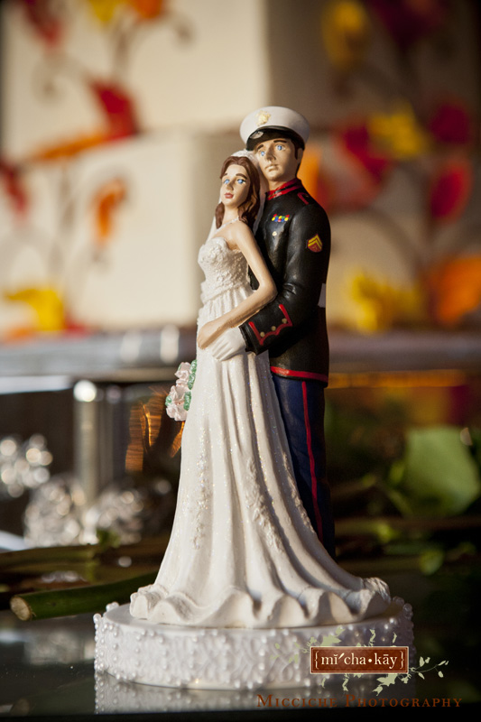 A military wedding themed cake topper at Autumn Creek Vineyards, a TriadWeddings venue in Mayodan, NC. Image by Mike Micciche Photography, TriadWeddings photographer in Greensboro.