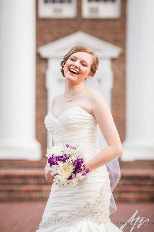 Meghan laughs at her fun Greensboro College bridal session by Aura Marzouk Photography, a Greensboro, NC Wedding Photographer and a TriadWeddings photography vendor.