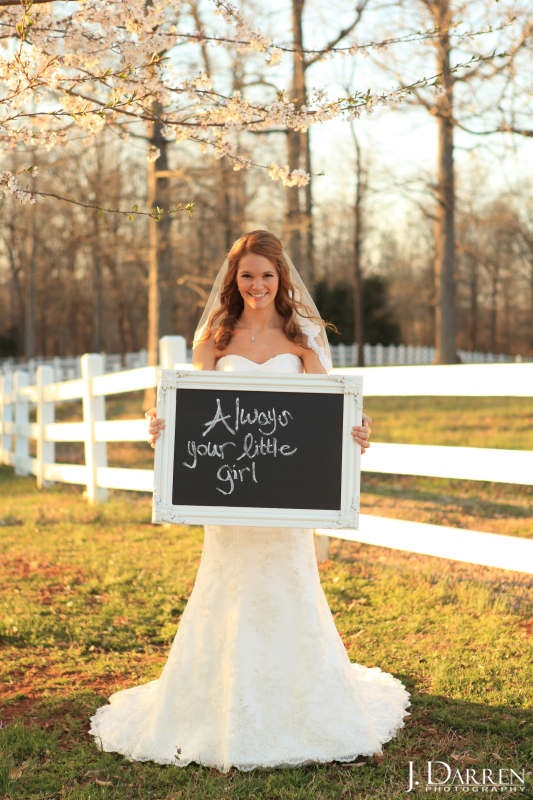 "Jennifer carries a chalkboard sign with a note to her dad: ""Always yours little girl."" An Adaumont Farm bridal session with J. Darren Photography, a Greensboro wedding photographer and a TriadWeddings vendor."