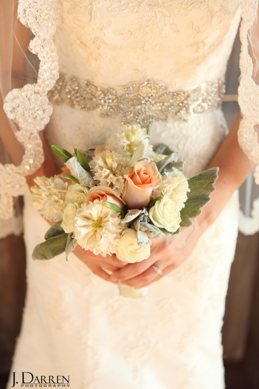 At Jennifer's Adaumont Farm bridal session she carries a peach and ivory bouquet from The Farmer's Wife. Image by J. Darren Photography, a Greensboro wedding photographer and a TriadWeddings vendor.
