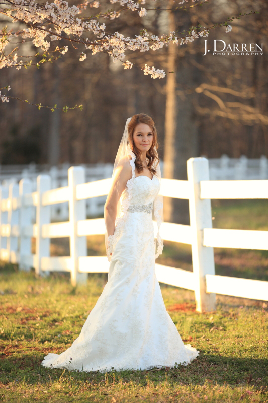 Jennifer wears a lovely mantilla lace veil with her ivory wedding gown at this Adaumont Farm bridal session with J. Darren Photography, a Greensboro wedding photographer and a TriadWeddings vendor.