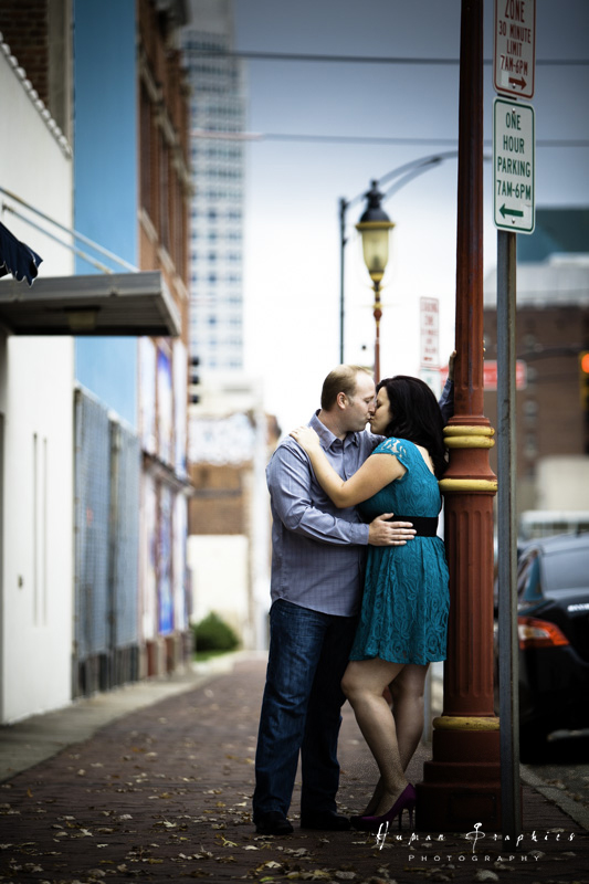 Adorable couple rock blue and turquoise at their downtown Winston Salem engagement session by Human Graphics Photography, a TriadWeddings vendor.