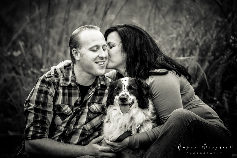 Couple pose with their dog in Winston Salem. Images by Human Graphics Photography, a TriadWeddings vendor.