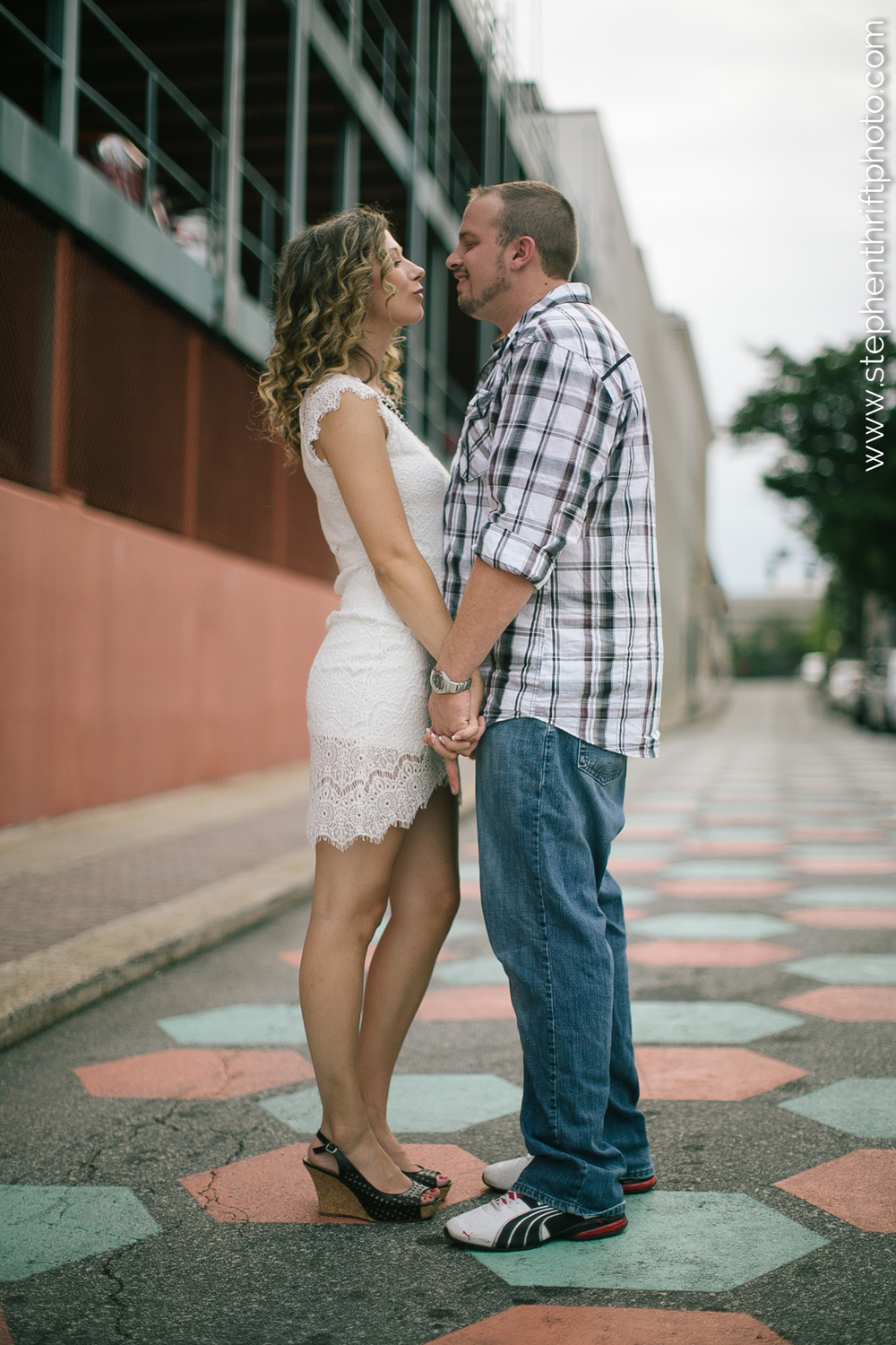 Whitney and Jason pose on the streets of downtown Greensboro with Stephen Thrift Photography.