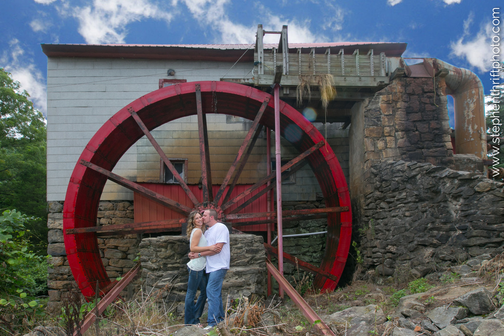 Whitney and Jason pose in front of the Old Mill in Guilford with Stephen Thrift Photography.