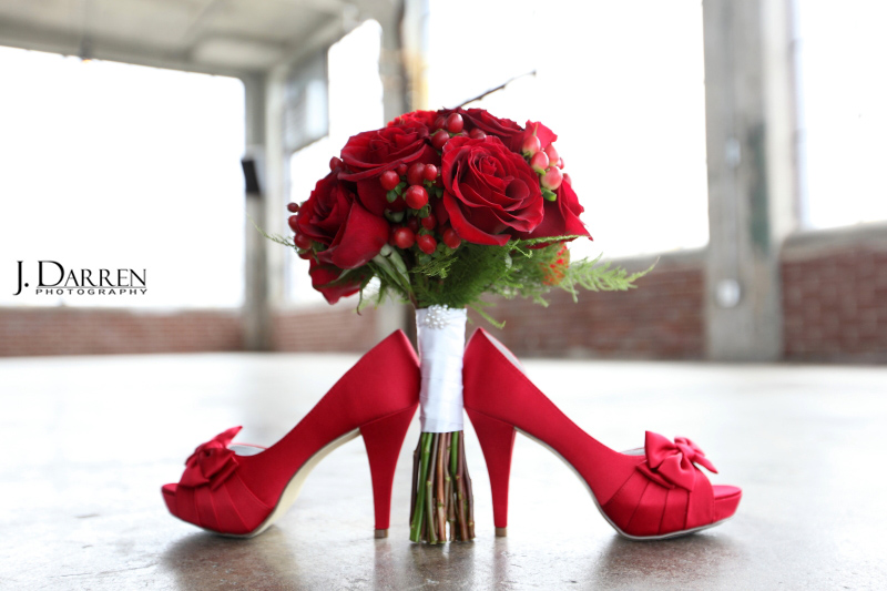 Bridal accessories; red heels with a bow, and red rose bouquet by Grace's Flower Shop.
