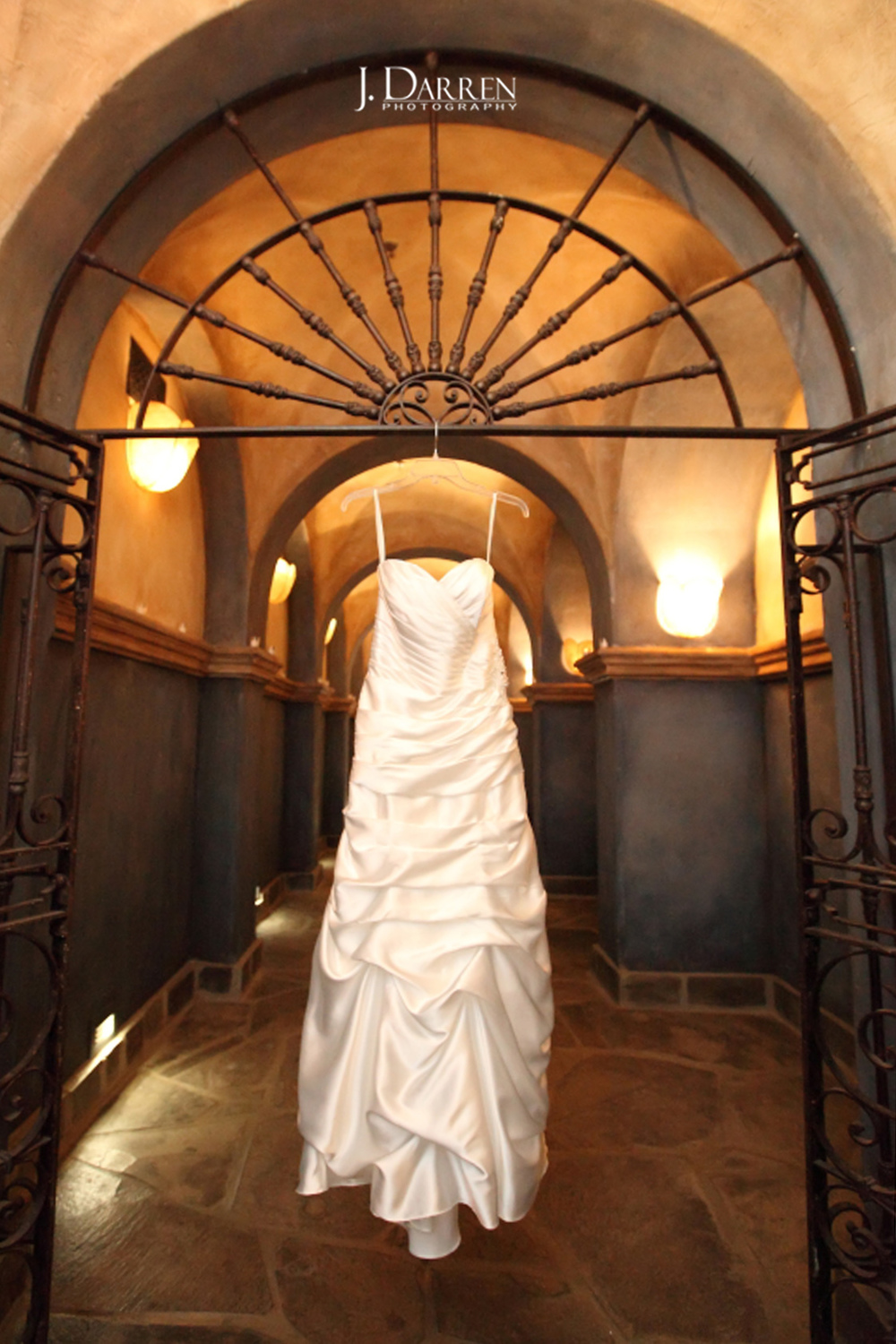 Bride's gown hangs at High Point wedding venue, Lofts at Union Square.