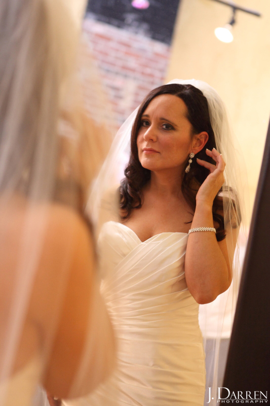 bride details, ivory gown, teardrop earrings, cathedral veil.