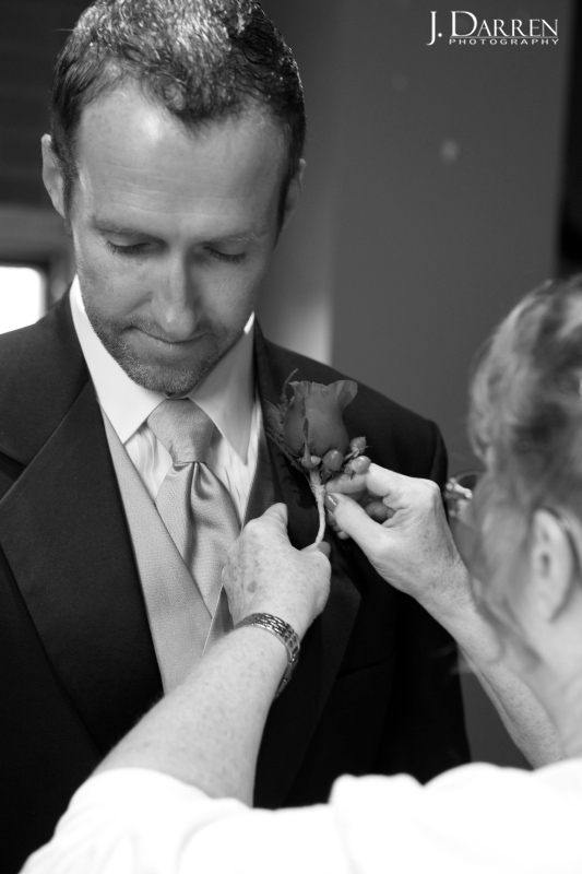 groom preparing for wedding at lofts at union square.