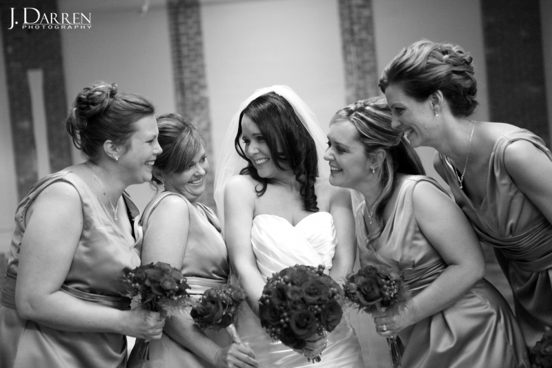 bridesmaids, fun posing, red rose bouquets. Image by J. Darren Photography.