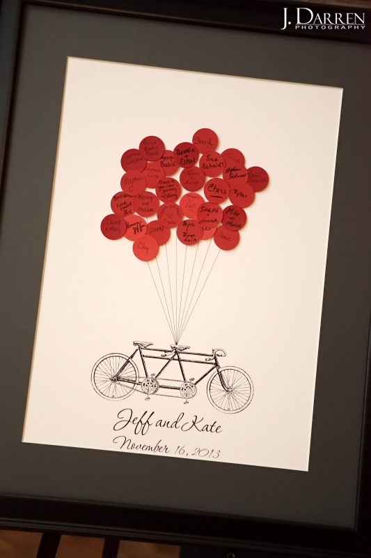 guest book idea, red balloons and bicycles. © J. Darren Photography