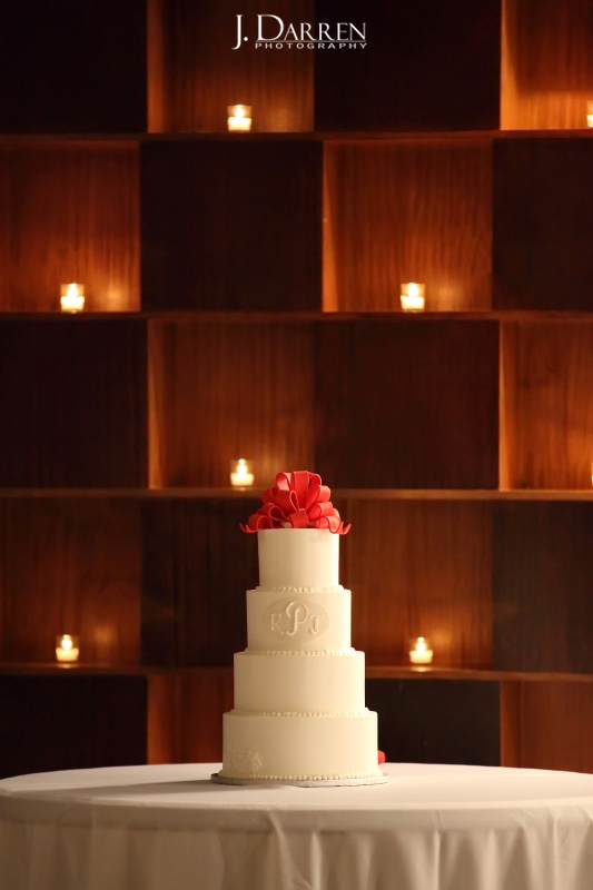 monogrammed wedding cake, red bow topper, by Cakes by Manfred. TriadWeddings vendor.