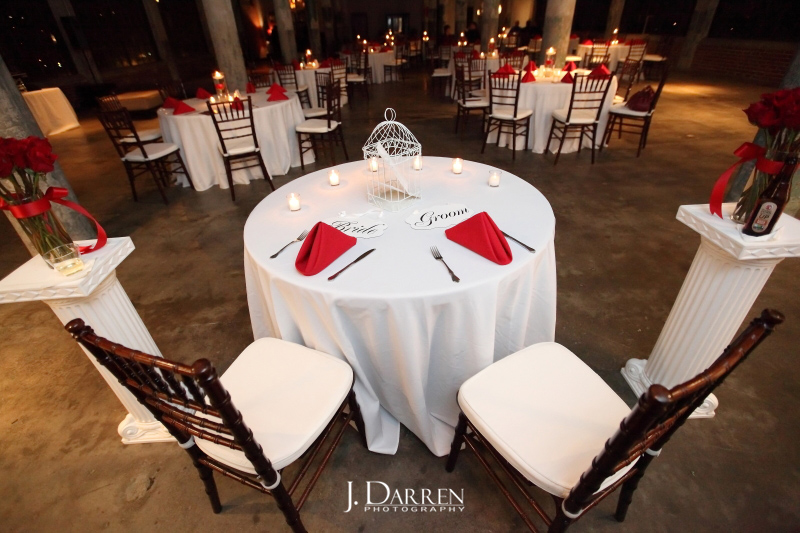 elegant red wedding, sweetheart table with columns and bird cage centerpiece.