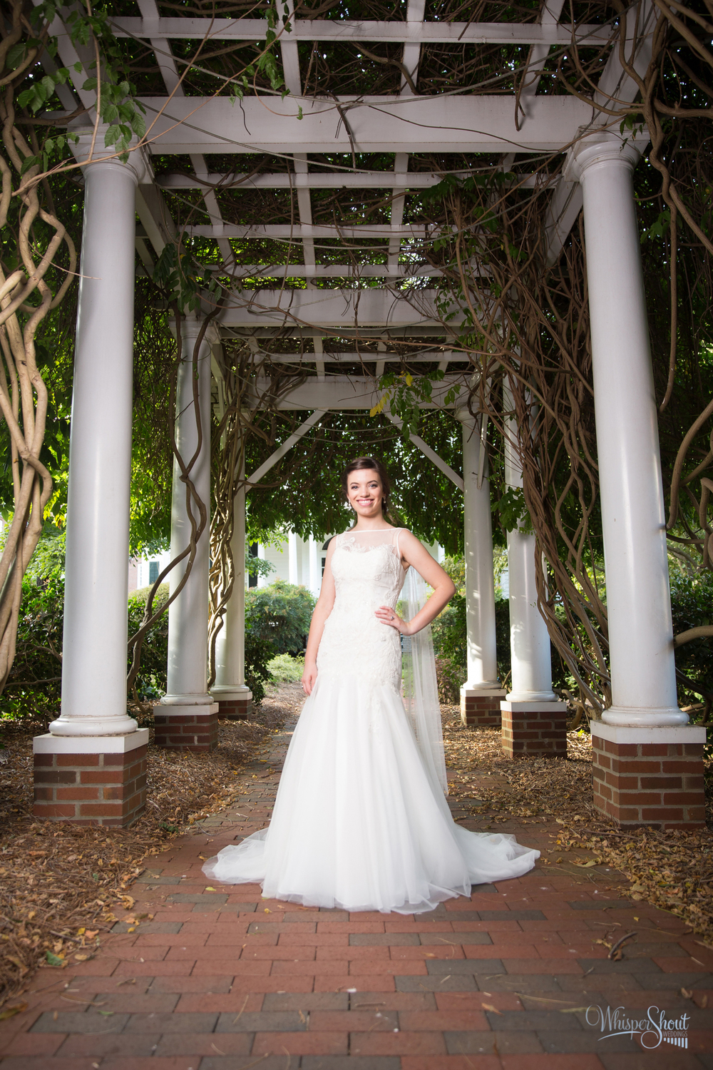 WhisperShout Weddings;  north carolina bridal session beneath an archway in Old Salem.