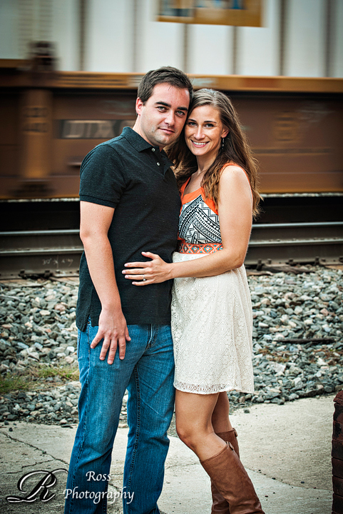 downtown engagement session by railroad tracks; triad, north carolina; robert ross photography.