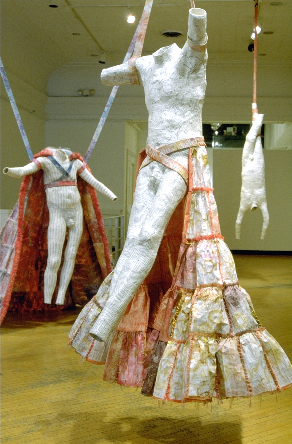 """Stimulated Desorption of Atoms and Molecules from Bodies in the Outer Solar System""       3 bodies each approximately 8' tall; science papers, fake fur, gauze. paint. glues, 4 audio systems with sensors; 2000"